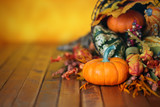 Pumpkins, gourds, and leaves in an Autumn cornucopia background - 175648436