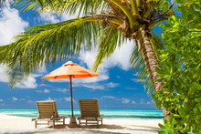 Beautiful beach. Chairs on the sandy beach near the sea. Summer holiday and vacation concept. Inspirational tropical scene. Tranquil scenery, relaxing tropical landscape design