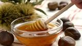 chestnuts honey in glass jar - closeup - 175656246