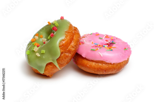 Pink and  green frosting doughnut  on a white background Poster