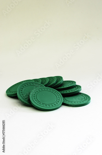 Vertical view of a Pile of green poker chips Poster