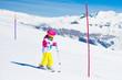 Quadro Ski and snow fun. Child in winter mountains.