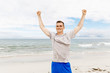 Quadro Young man in sport wear with outstretched arms