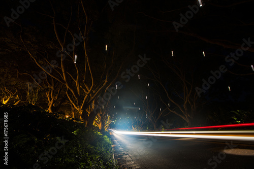 Deurstickers Nacht snelweg Blurred headlights on a moving car
