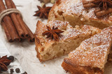 Homemade Apple pie with cinnamon, cardamom and star anise closeup. Traditional autumn cakes for tea. Selective focus - 175700611