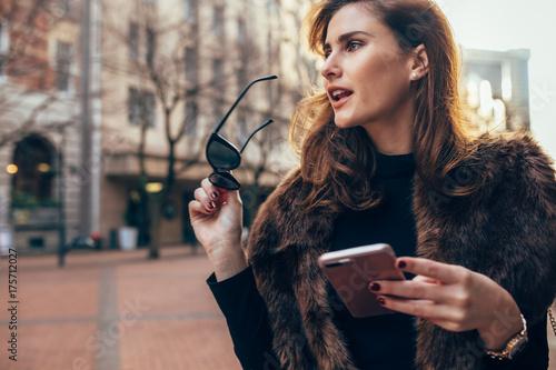 Beautiful woman walking down the street Poster
