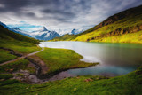 Panorama of Mt. Schreckhorn and Wetterhorn. Location place Bachalpsee in Swiss alps, Grindelwald, Europe.
