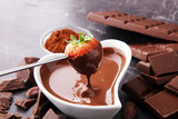 Fondue with Melting chocolate or melted chocolate and strawberry. - 175733215