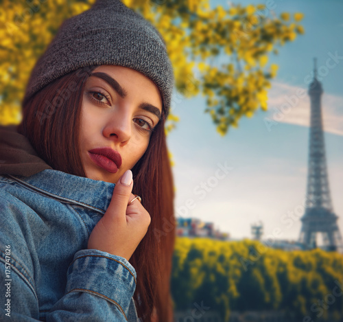 Poster girl against the backdrop of the eiffel tower in Paris
