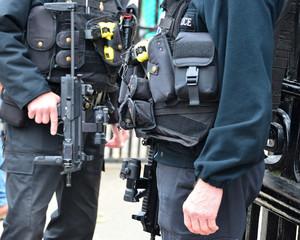Armed policemen London.