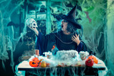 Witch Tells Magic Words To Skull - 175753475