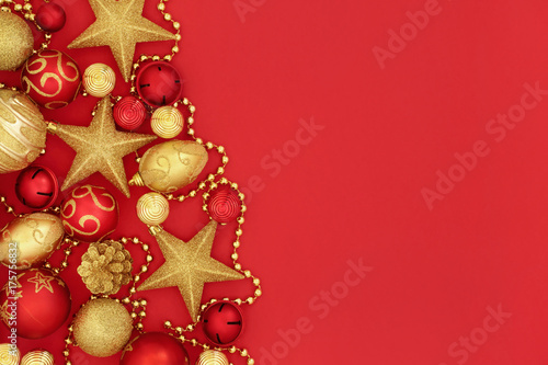 Christmas red and gold bauble decorations forming a background.