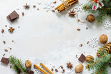 Ingredients for Christmas baking - chocolate, cinnamon, anise and nuts on a stone or slate background. Seasonal, food background. - 175767021