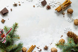 Ingredients for Christmas baking - chocolate, cinnamon, anise and nuts on a stone or slate background. Seasonal, food background. - 175767061