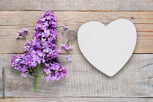 Lilac flowers and white heart on old wooden background Plakat