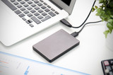 External backup disk hard drive connected to laptop - 175778089