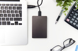 External backup disk hard drive connected to laptop - 175778091