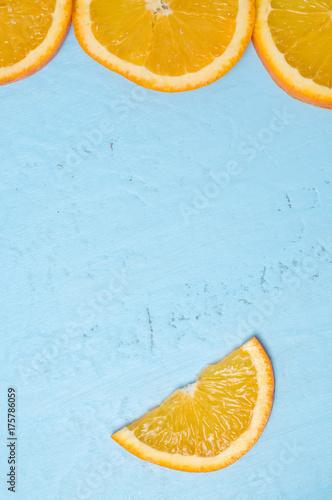 Orange Slices on Aqua Colored Background - 175786059