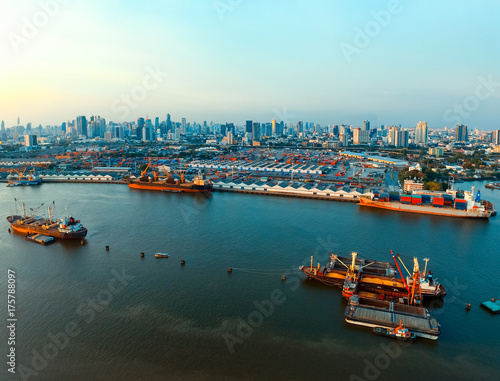 Staande foto Bangkok aerial view of commercial ship and container dock in chaopraya river with urban skyline in bangkok thailand capital