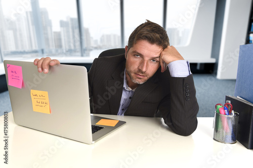 wasted businessman working in stress at office laptop computer looking exhausted