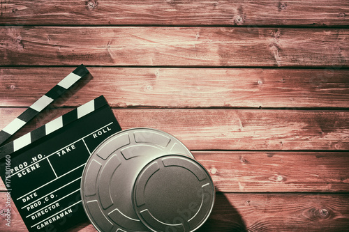 Poster Clapperboard and reels of film in canisters