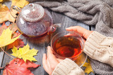 Autumn Still Life: Tea on maple leaves on a wooden table - 175805461