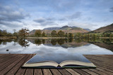 Stuning Autumn Fall landscape image of Lake Buttermere in Lake District England concept coming out of pages in open book - 175807005