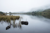 Landscape of Llyn Crafnant during foggy Autumn morning in Snowdonia National Park - 175808267