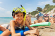 Boys and girls in scuba masks on the beach