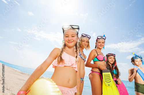 Cute group of kids having fun on the beach