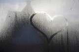 wet window with heart shaped hand drawning - 175814421