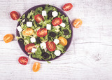 Greek salad with fresh vegetables, feta cheese and black olives. - 175819253