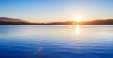 Wonderful Sunrise over lake scenery in blue and yellow colors. Panoramic side ratio photo. - 175819612