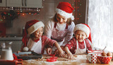 happy family mother and children  bake cookies for Christmas - 175819854