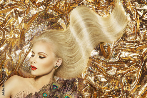 Keuken foto achterwand Kapsalon Fashion Model Hairstyle and Beauty Makeup, Woman Waving Golden Color Hair Style and Beautiful Make Up, Gold Fabric Background
