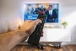 canvas print picture - Fernsehen mit Fernbedienung in der Hand