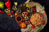 Vegetarian crumbly pearl barley porridge with vegetables  in a dark background. Flat lay. Top view - 175843052