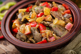 Roast chicken liver with vegetables on wooden background. - 175843079