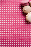 Lovely composition of macaroons. Sweet colorful cakes on heart figured cloth, top view. Love of desserts and sweets concept - 175848259