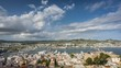 Aerial panorama of Eivissa port and old town buildings in Ibiza, Spain. Time lapse with dynamic clouds