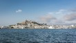 Ibiza Eivissa old town with castle on the hill, Spain. Time lapse with moving clouds