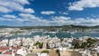 High angle panorama of Eivissa port and old town buildings in the morning, Ibiza, Spain. Time lapse with dynamic clouds