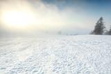sunrise in fog on the snowy mountain top - 175851036