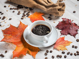 Autumn, autumn leaves, maple, hot Cup, coffee beans on the background of wooden table. Seasonal, morning coffee, Sunday rest and the concept of still life. - 175851843