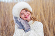 Woman wearing funny and cozy hat and gloves