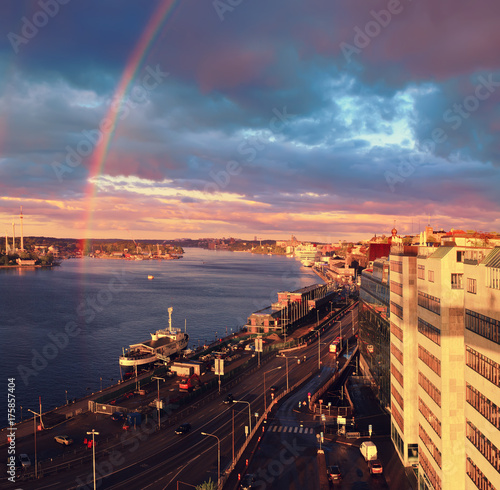 Beautiful sunset with rainbow and dark blue sky over the Stockholm - the capital Poster