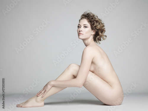 Fotobehang Women Art Nude woman with elegant hairstyle on gray background