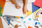 Early children education. Artistic child. Unrecognizable creative kid top view, colorful drawing process, creativity concept - 175862088