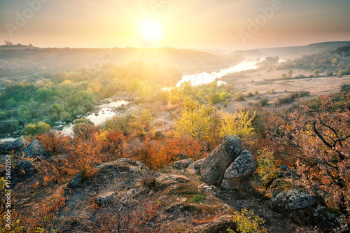 Tuinposter Herfst Valley with mountain river in the rocky shores at sunset