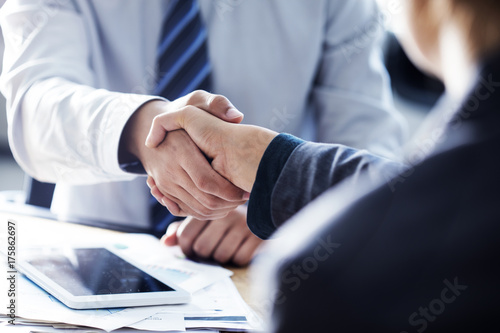 Poster Business handshake in the office